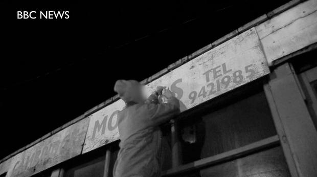 Photo issued by BBC News of a sign being corrected by a self-confessed
