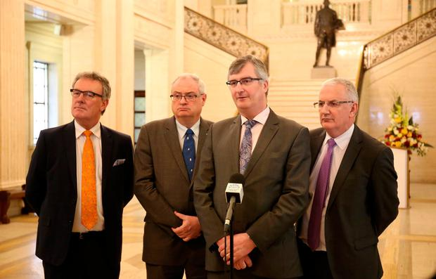 Ulster Unionist Party's Mike Nesbitt, Steve Aiken, Tom Elliott and Danny Kennedy speak to members of he media in the Great Hall in Parliament Building in Stormont, Belfast, where talks aimed at restoring Northern Ireland's powersharing government have resumed. PA