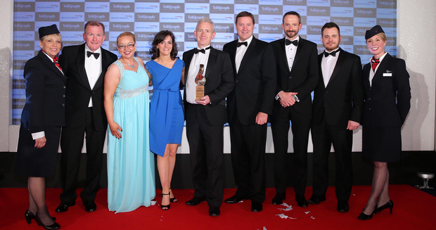 Stephen Humphreys (third from right) of British Airways and Richard McClean (far left), managing director of the Belfast Telegraph, present the Overall Business of the Year Award in 2015 to Novosco