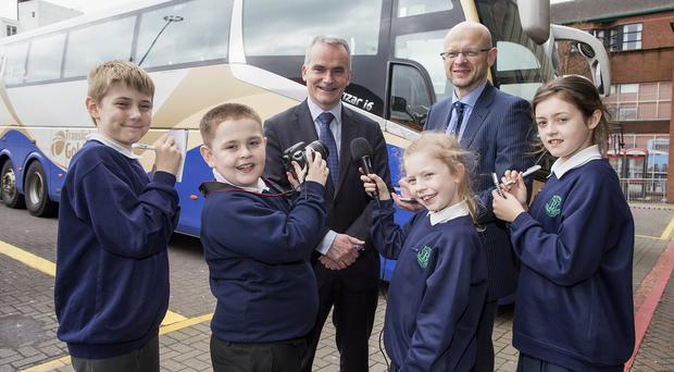 Chris Conway, Group Chief Executive of Translink, gets grilled by Little Reporters from Blythefield Primary School and Darwin Templeton, Managing Editor of Independent News & Media NI.