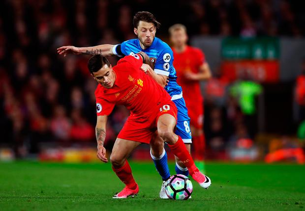 Philippe Coutinho of Liverpool (L) and Harry Arter of AFC Bournemouth (R) battle for possession during the Premier League match between Liverpool and AFC Bournemouth at Anfield on April 5, 2017 in Liverpool, England. (Photo by Clive Brunskill/Getty Images)