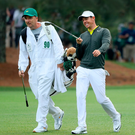 Walk this way: Rory McIlroy and caddy JP Fitzgerald during practice at Augusta. Photo: Andrew Redington/Getty Images