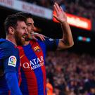Barcelona's Argentinian forward Lionel Messi (L) is congratulated by Barcelona's Uruguayan forward Luis Suarez after scoring during the Spanish league football match FC Barcelona vs Sevilla FC at the Camp Nou stadium in Barcelona on April 5, 2017. / AFP PHOTO / Josep LAGOJOSEP LAGO/AFP/Getty Images