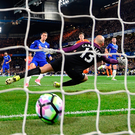 Hazard tucks away the rebound after having his penalty saved. Photo: Mike Hewitt/Getty Images