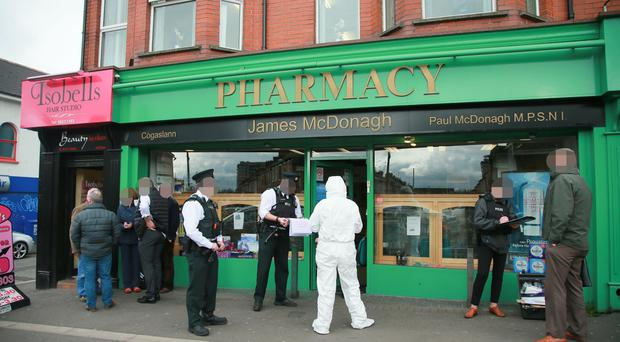 Police and forensics at the scene of an attempted robbery on a pharmacy on the Falls road which resulted in a stabbing on April 6th 2017 (Photo - Kevin Scott / Belfast Telegraph)