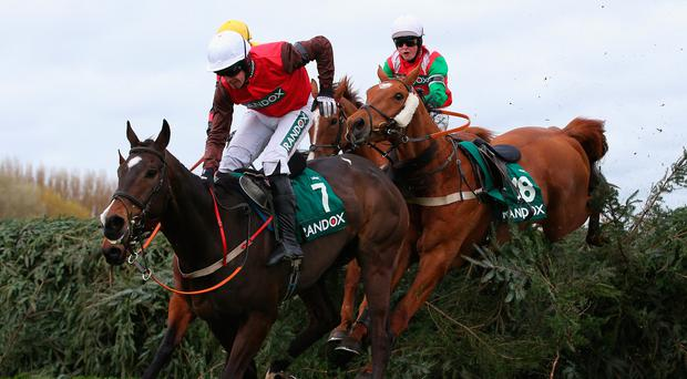 Dineur ridden by James King (green sleeves) clears the last fence behind Darwins Fox ridden by Barry O'Neill on their way to winning the Randox Health Foxhunters' Open Hunters' Steeple Chase at Aintree. Photo: Alex Livesey/Getty Images