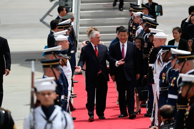 Secretary of State Rex Tillerson talks with Chinese President Xi Jinping after he arrived at Palm Beach International Airport April 6, 2017 in West Palm Beach, Florida. (Photo by Joe Raedle/Getty Images)