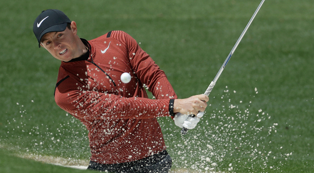 Digging in: Rory McIlroy in action at Augusta. Photo: Chris Carlson/AP