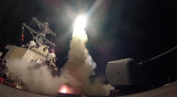 In this handout provided by the U.S. Navy,The guided-missile destroyer USS Porter fires a Tomahawk land attack missile on April 7, 2017 in the Mediterranean Sea. (Photo by Ford Williams/U.S. Navy via Getty Images)