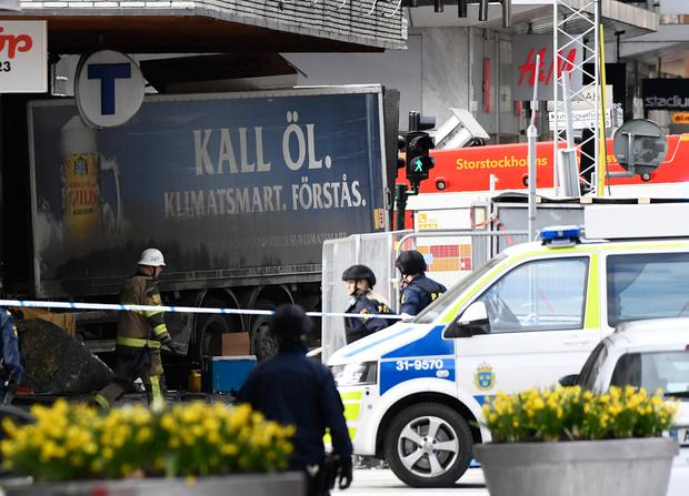 Police cordon the truck which crashed into the Ahlens department store at Drottninggatan in central Stockholm, April 7, 2017. AFP/Getty Images