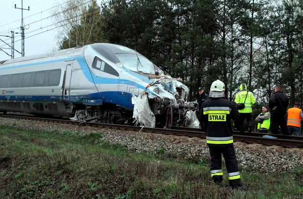 Emergency services work at the scene where a collision of a train and a truck in Schodnia, south Poland, on April 7, 2017 where nineteen people were injured. AFP/Getty Images