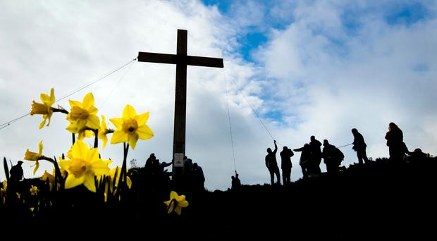 Christian message: the cross, like this one erected at the Chevin outside Leeds every year, is the true symbol of Easter. Photo: Danny Lawson/PA Wire
