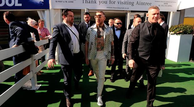 Conor McGregor (centre) on Grand National Day of the Randox Health Grand National Festival at Aintree Racecourse. Peter Byrne/PA Wire