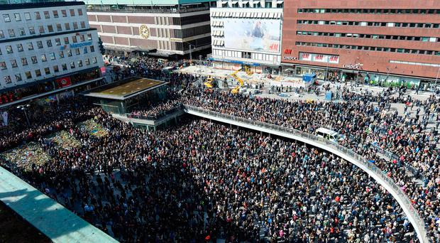People attend a memorial ceremony on April 9, 2017 at Sergels Torg plaza in Stockholm, close to the point where a truck drove into a department store two days before. Four people died and fifteen were injured when a truck plunged into a crowd at a busy pedestrian street in the Swedish capital on April 7, 2017. / AFP PHOTO / Jonathan NACKSTRANDJONATHAN NACKSTRAND/AFP/Getty Images