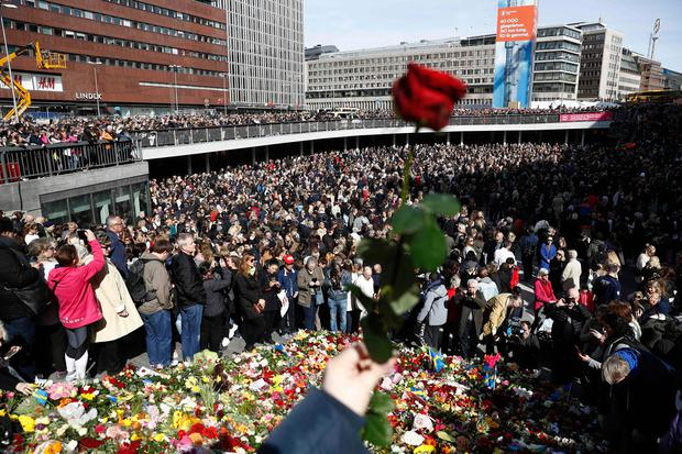 People attend a memorial ceremony on April 9, 2017 at Sergels Torg plaza in Stockholm, close to the point where a truck drove into a department store two days before. Four people died and fifteen were injured when a truck plunged into a crowd at a busy pedestrian street in the Swedish capital on April 7, 2017. / AFP PHOTO / Odd ANDERSENODD ANDERSEN/AFP/Getty Images