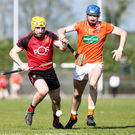 Sticking point: Down's Malachy Magee battles for possession with Niall Strain