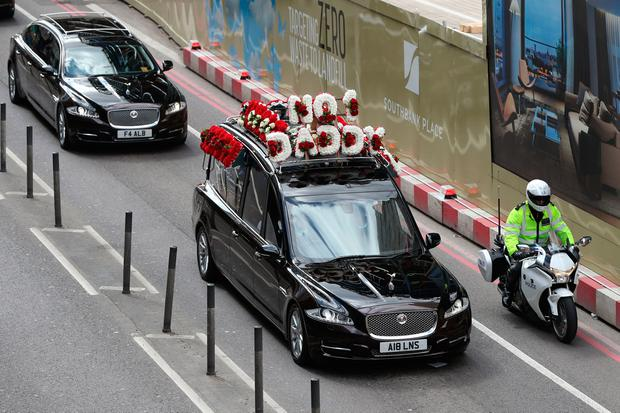 The coffin of Pc Keith Palmer makes it's way along York Road to Southwark Cathedral in London after resting overnight at Westminster's Chapel of St Mary Undercroft.