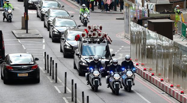 The coffin of Pc Keith Palmer makes its way along York Road to Southwark Cathedral in London after resting overnight at Westminster's Chapel of St Mary Undercroft.