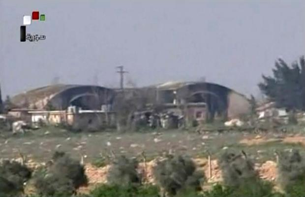 This frame grab from video provided by the Syrian official TV, a Syrian government channel that is consistent with independent AP reporting, shows the burned and damaged hangar warplanes which attacked by US Tomahawk missiles, at the Shayrat Syrian government forces airbase, southeast of Homs, Syria, Friday April, 7, 2017. (Syrian government TV, via AP)