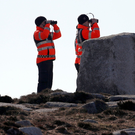 Members of the Irish Coastguard searching along the coastline near Blacksod, Co Mayo