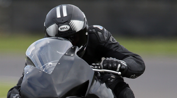 Man in black: Dan Hegarty, set for his second NW200, tests a Honda CBR1000SP2 at Castle Coombe