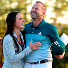 Bliss: Sergio Garcia embraces fiancee Angela Akins in celebration after his Masters triumph