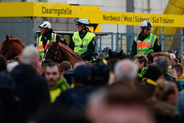 Police patrol on horseback outside the stadium after the team bus of Borussia Dortmund had some windows broken by an explosion some 10km away from the stadium prior tothe UEFA Champions League 1st leg quarter-final football match BVB Borussia Dortmund v Monaco in Dortmund, western Germany on April 11, 2017. AFP/Getty Images