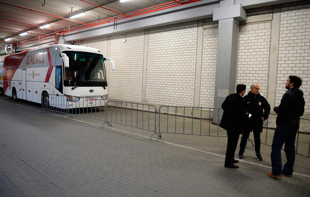 The AS Monaco bus are pictured inside stadium after the team bus of Borussia Dortmund had some windows broken by an explosion some 10km away from the stadium prior tothe UEFA Champions League 1st leg quarter-final football match BVB Borussia Dortmund v Monaco in Dortmund, western Germany on April 11, 2017. / AFP PHOTO / Sascha SchuermannSASCHA SCHUERMANN/AFP/Getty Images