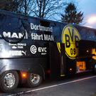 Borussia Dortmund's damaged bus is pictured after an explosion some 10km away from the stadium prior to the UEFA Champions League 1st leg quarter-final football match BVB Borussia Dortmund v Monaco in Dortmund, western Germany on April 11, 2017. AFP/Getty Images