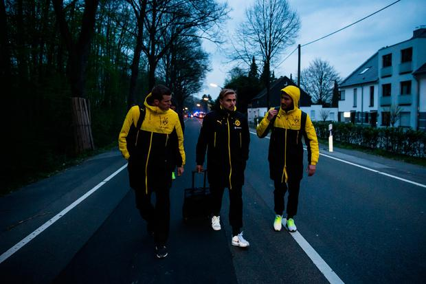 Players are escorted after the team bus of the Borussia Dortmund football club was damaged in an explosion on April 11, 2017 in Dortmund, Germany. (Photo by Maja Hitij/Getty Images)