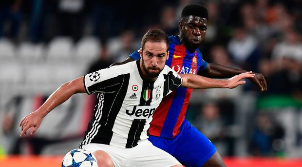 Barcelona defender Samuel Umtiti vies with Juventus forward from Argentina Gonzalo Higuain.