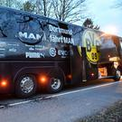 A window of Dortmund's team bus is damaged after an explosion before the Champions League quarter-final soccer match in Dortmund, western Germany.