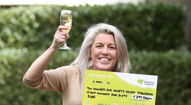 Niamh O'Meara, pictured at National Lottery Headquarters picking up a cheque for €297,860 from her win on Euromillions