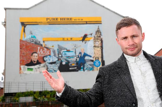 Undated handout photo issued by Diageo of boxer Carl Frampton who has unveiled a new street mural celebrating his exploits in the ring and other famous products of Belfast. PA