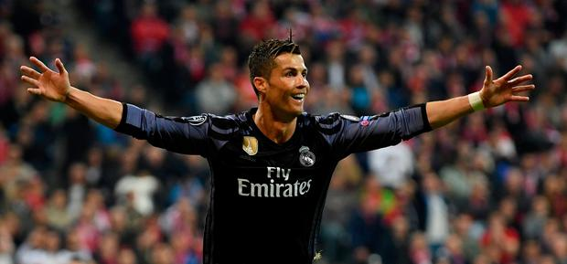 Cristiano Ronaldo of Real Madrid celebrates after he scores his team's 2nd goal during the UEFA Champions League Quarter Final first leg match between FC Bayern Muenchen and Real Madrid CF at Allianz Arena on April 12, 2017 in Munich, Germany. (Photo by Matthias Hangst/Bongarts/Getty Images)