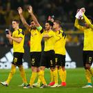 Defiant: Borussia Dortmund players, who came under terrorist attack on Tuesday night, hail fans after last night's 3-2 Champions League defeat by Monaco