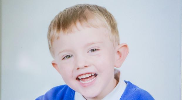 Thomas Magee - in a school photo delivered to his family the day before he died