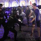 MADRID, SPAIN - APRIL 11: Police clash with Leicester City fans in the Plaza Mayor on April 11, 2017 in Madrid, Spain. (Photo by Getty Images)