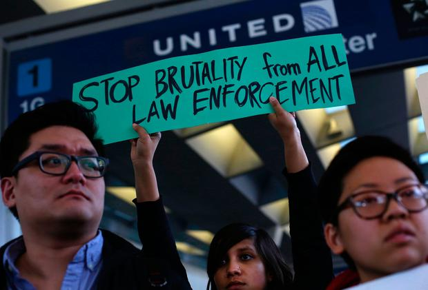 Demonstrators protest United Airlines at O'Hare International Airport on April 11, 2017 in Chicago, Illinois. AFP/Getty Images
