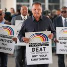 Civil rights leader Reverend Jesse Jackson leads a small group from the Rainbow PUSH Coalition in a protest outside the United Airlines terminal at O'Hare International Airport on April 12, 2017 in Chicago, Illinois. (Photo by Scott Olson/Getty Images)