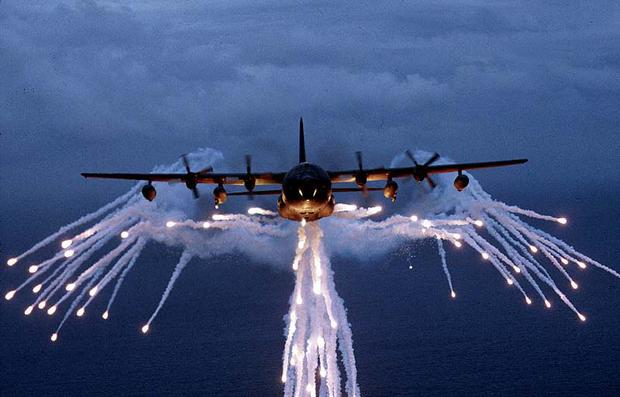 A United States Air Force MC-130 using flares. (File photo, USAF)