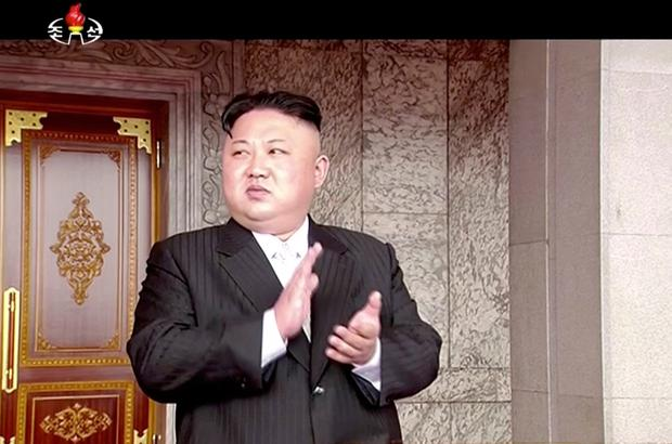 In this image made from video broadcast by North Korean broadcaster KRT, North Korea's leader Kim Jong Un applauds during a parade at Kim Il Sung Square in Pyongyang, Saturday, April 15, 2017. North Korean leader Kim Jong Un has appeared in a massive parade in the capital, Pyongyang, celebrating the birthday of his late grandfather and North Korea founder Kim Il Sung. (KRT via AP)