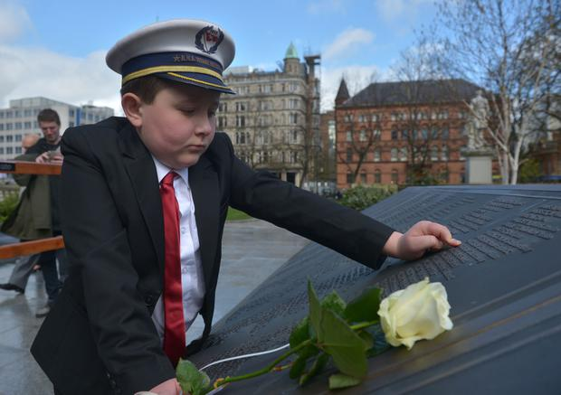 Liam McDonald from Belfast leaves a rose in memory of the victims of the Titanic during the 105th memorial service held at City Hall on Saturday. Photo by Aaron McCracken/Harrisons 07778373486