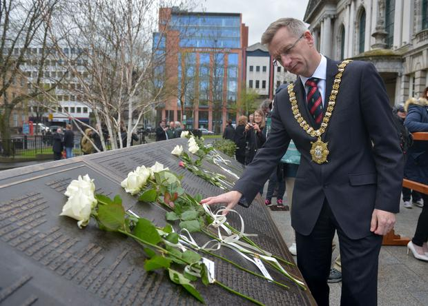 Belfast Lord Mayor Brian Kingston views the roses left in memory of the victims of the Titanic during the 105th memorial service held at City Hall on Saturday. Photo by Aaron McCracken/Harrisons 07778373486