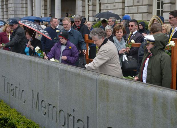 Relatives of Titanic victims and members of the public lay roses in memory of the victims of the Titanic during the 105th memorial service held at City Hall this morning (Saturday). Photo by Aaron McCracken/Harrisons