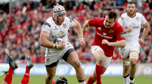 Straight ahead: Ulster's Luke Marshall makes a break to score a try