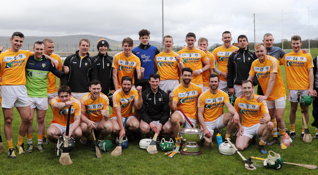 Team effort: Antrim celebrate after conquering Armagh in the Ulster final