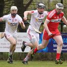 Race is on: Derry's Gavin McCormick breaks free from Tyrone's Stephen Donnelly and Ruairi Devlin