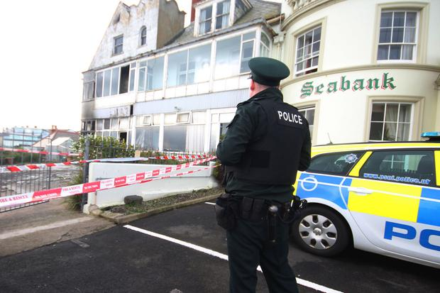 Police at the scene of a fire at an unoccupied house in Portrush in the early hours of Monday morning. 17-04-17 Picture: MARK JAMIESON.