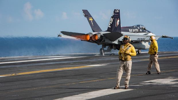 An F/A 18C Hornet from the Blue Blasters of Strike Fighter Squadron (VFA) 34 as it takes off from the aircraft carrier USS Carl Vinson (CVN 70) on April 12, 2017.
